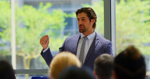 Caucasian male speaker speaks in the business seminar 4k Live Action