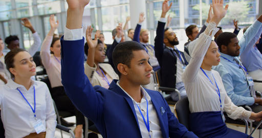 Multi ethnic business people raising hands in the business seminar 4k Live Action