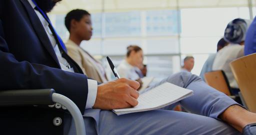 Mixed race businessman attending a business seminar 4k Live Action