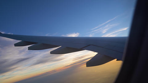 the wing of the aircraft at sunset. air transportation and travel. aviation Live Action