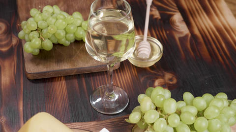 A glass of white wine shot from above on a wooden background ライブ動画
