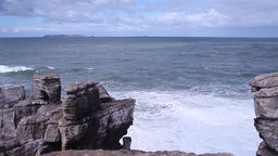 Cliffs of rock with the ocean behind in Peniche Portugal Footage