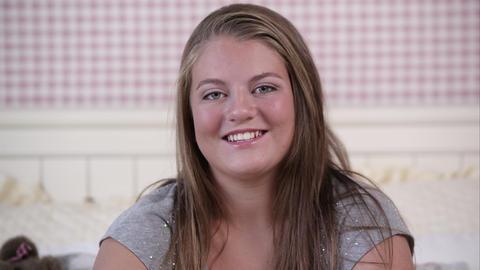 Slow motion push of teenage girl smiling Footage