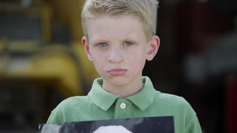 Slow motion from boys face to photo of him showing photo with cleft palate Footage