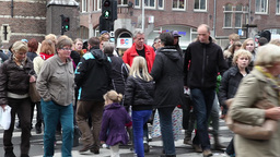 people crossing crosswalk in a street in amsterdam, netherlands Footage