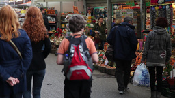 people walking in flowers market in amsterdam Footage