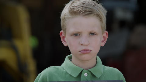 Slow motion from photo to boys face of him showing photo with cleft palate Live Action