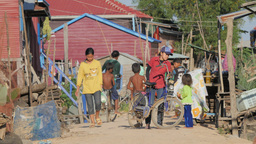 Village scene with kids and bicycles,Phnom Krom,Cambodia Footage