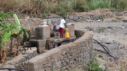 man taking water from the well in Cape Verde Africa Footage