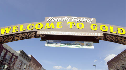 Up close wide pan to the right of the Welcome to Golden Colorado Sign Footage