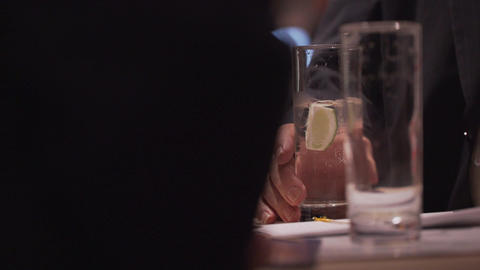 Man holds drink at a conference Footage