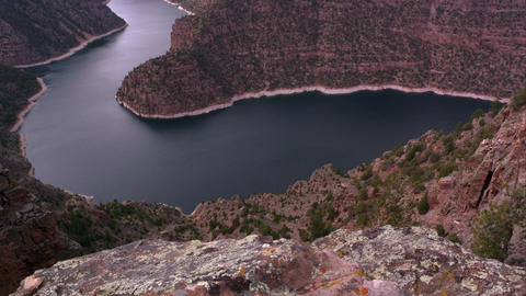 Doward angle dolly shot overlooking Flaming Gorge from Red Canyon overlook Footage