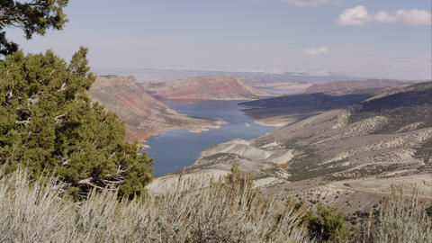 Dolly shot overlooking Flaming Gorge in the distance Footage