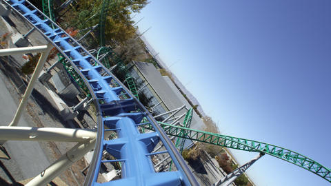 First person view of a roller coaster riding the peaks and slopes of the track Footage