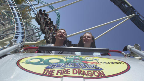 Shot of couple screaming upside down on rollercaoster ride Footage