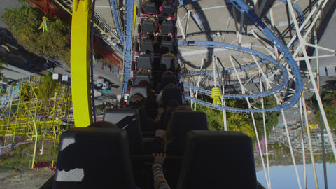 Shot from the back of a rollercoaster riding the twists of the track Footage