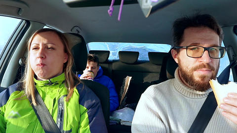 Family dad, mom and son eat in the car sandwich Footage