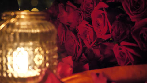 A bouquet of red roses candlelight Footage
