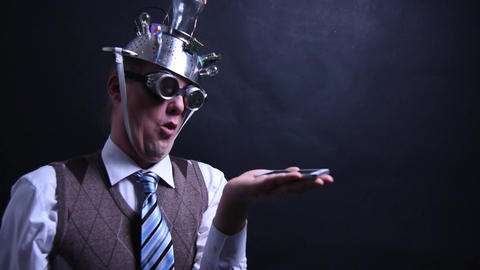 Nerd with aluminum hat looks at his cellphone with empty placeholder for Live Action