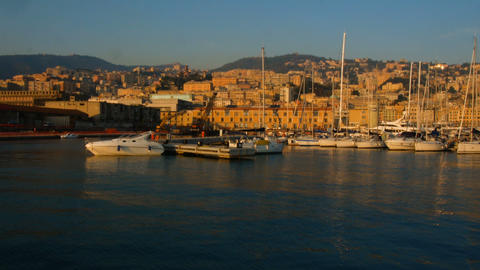 view at sunset over the old port of Genoa, towards the mountainous part Live Action