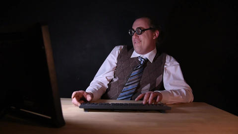 Nerd is sitting at the PC and typing Live Action