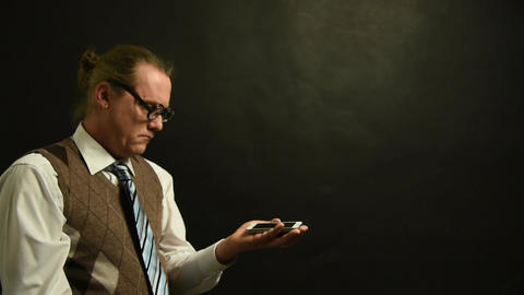 Funny Nerd boss looks at his cell phone Live Action
