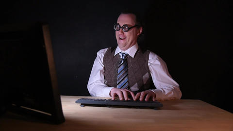 Nerd is sitting at the PC and typing Footage