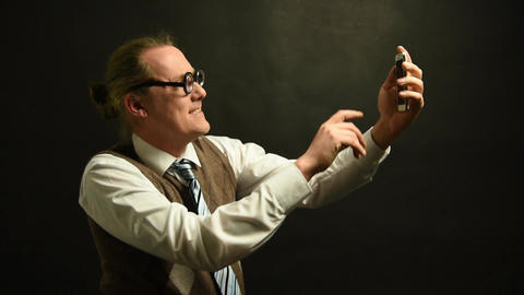 Nerd Boss takes a selfie with his mobile phone Footage