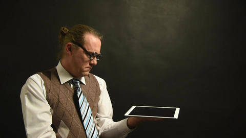 Nerd Boss with his tablet - overwhelmed by the information Footage