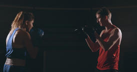 Young adult woman doing kickboxing training with her coach Footage