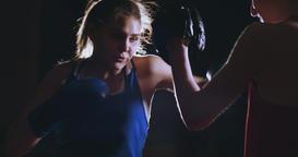 Medium shot of beautiful fitness woman boxer treneruemsya strike speed focus Footage