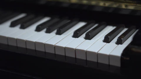 Close up view of piano keys. Piano keyboard background with selective focus ビデオ