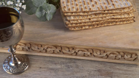 Pesach Passover symbols of great Jewish holiday. Traditional matzoh, matzah or Live Action