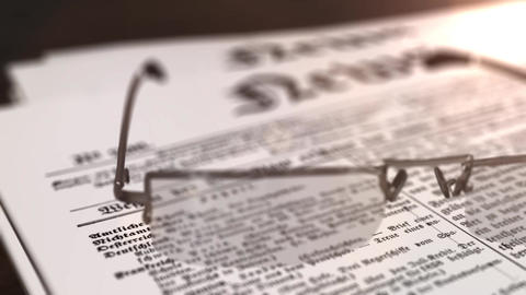 glasses with newspaper with the headline News on a table Animation
