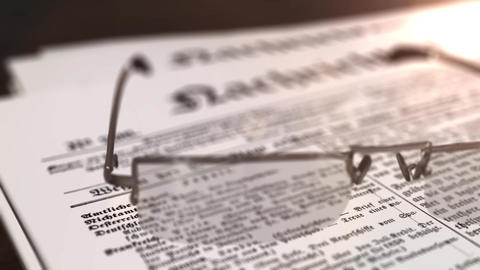 glasses with newspaper with the headline Nachrichten - german word for news - on Animation