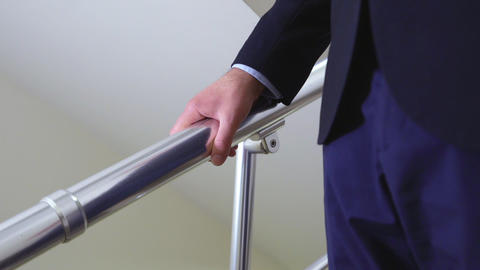 close view businessman goes down stairs slow motion Footage