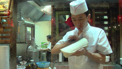 Chinese Chef Making Knife Cut Noodle Footage