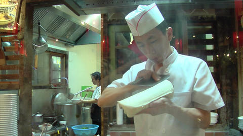 Chinese Chef Making Knife Cut Noodle Stock Video Footage
