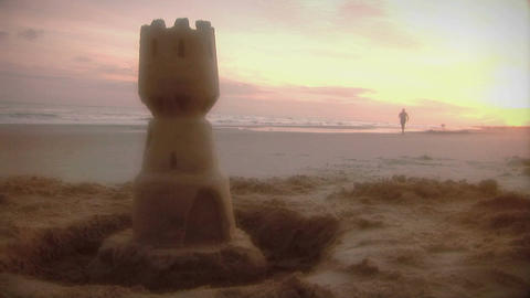 1006) Beach Jogger and Sand Castle Sunrise Stock Video Footage