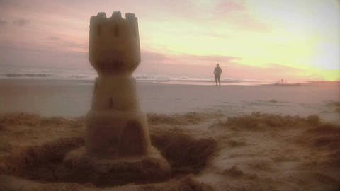 1006) Beach Jogger and Sand Castle Sunrise Footage