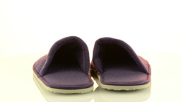 A pair of purple slippers Stock Video Footage