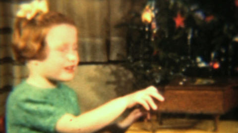 Girl Plays Toy Piano By Christmas Tree 1942 HD Stock Video Footage