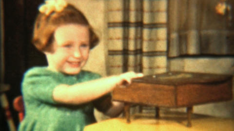 Girl Plays Toy Piano By Christmas Tree 1942 HD stock footage