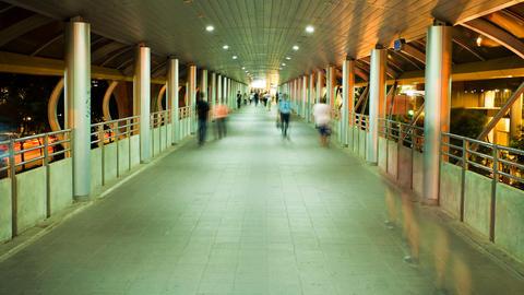 Motion Timelapse - Pedestrians in Skytrain walkway Stock Video Footage