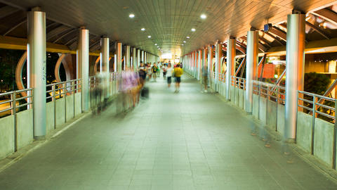 Motion Timelapse - Pedestrians In Skytrain Walkway stock footage