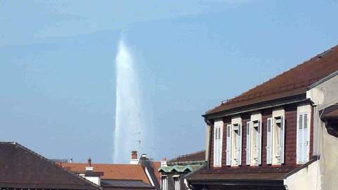 Fountain of Geneva above roofs Footage