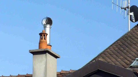 Steel Ventilator On A Roof stock footage