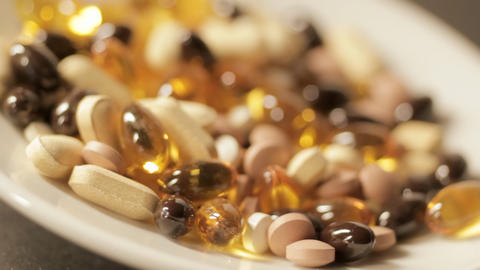 Plate of vitamin pills Stock Video Footage