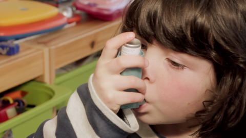 Small girl using asthma inhaler Stock Video Footage