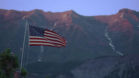 American flag waving in front of a mountain Footage